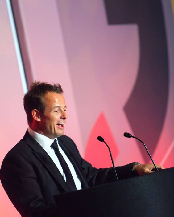 Austin Healey speaking at an event