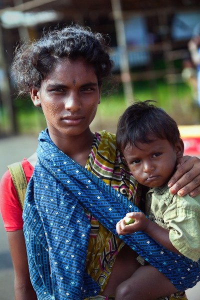Lady with Child in arms begging Anjuna Flea Market GOA