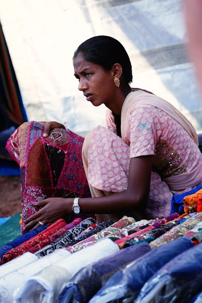 Lady selling india fabrics at Anjuna Flea Market