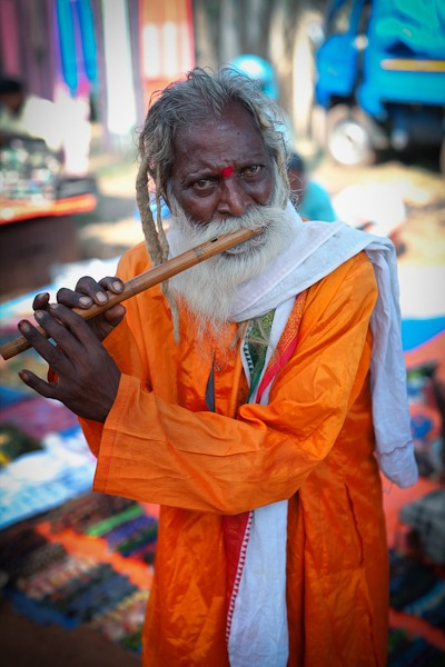 Man playing the flute for money Anjuna Flea Market Goa