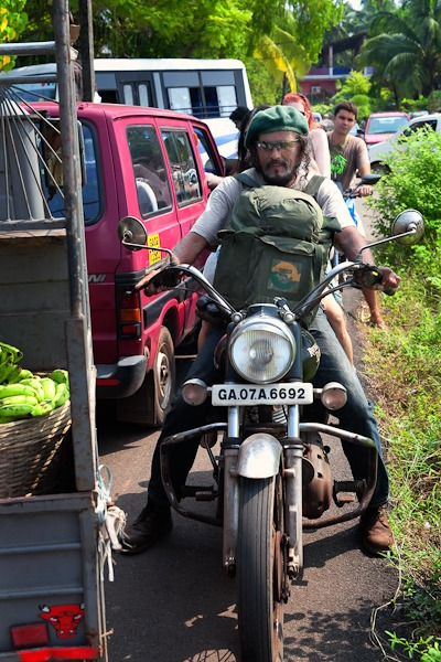 Man on old enfield motorbike anjuna flea market goa india