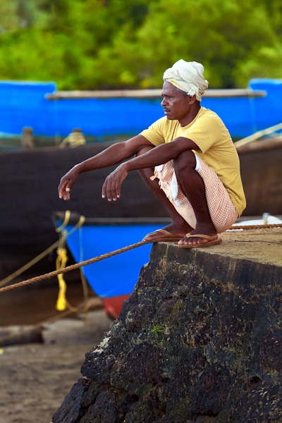 Man Sat on Dock Terekhol Goa India