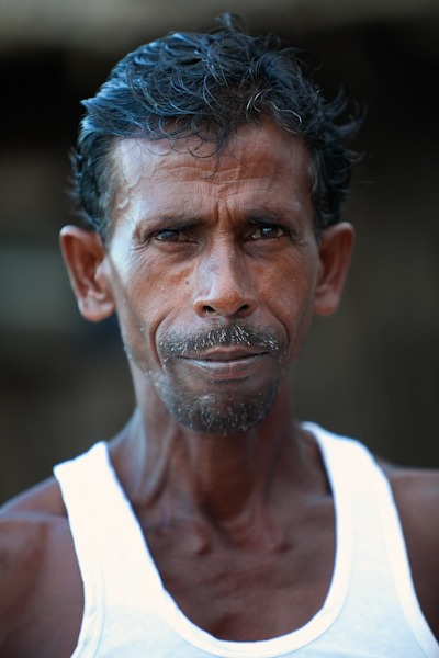 Close up of man stood outside shanti in GOA