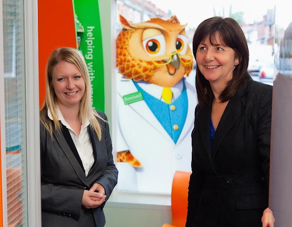 lesley griffiths smiling and looking at the new customer consulation area at rowlands pharmacy wrexham