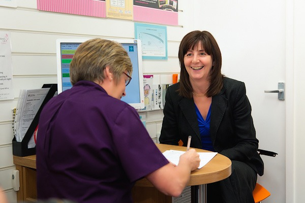 lesley griffiths welsh assembly member for heath smiling inside rowlands pharmacy consulation room wrexham