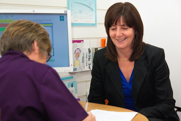 lesley griffiths mp for wales in rowlands pharmacy consultation room wrexham