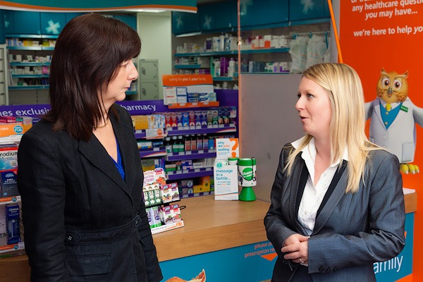 lesley talking to rowlands area manchester beth in front of pharmacy counter