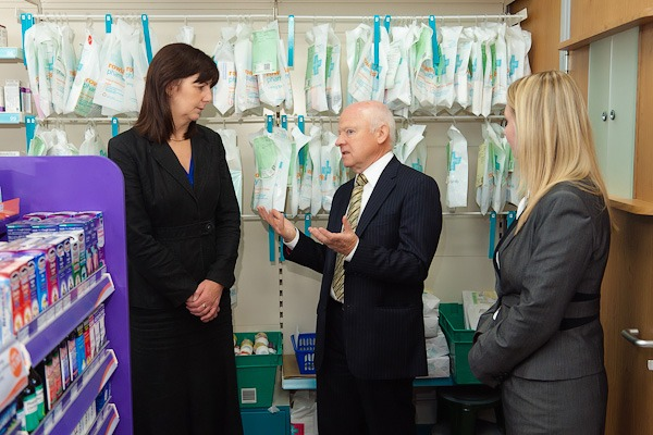 lesley griffiths mp for wales smiling in front of rowlands perscription dispensing area