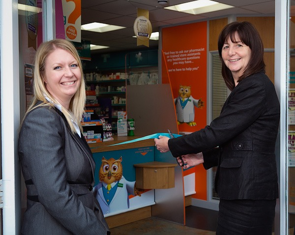 lesley griffiths cuts the ribbon to open rowlands pharmacy wrexham with beth area manager
