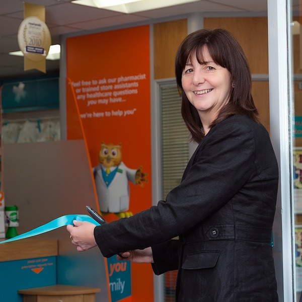lesley griffiths mp cutting tape to open rowlands pharmacy wrexham