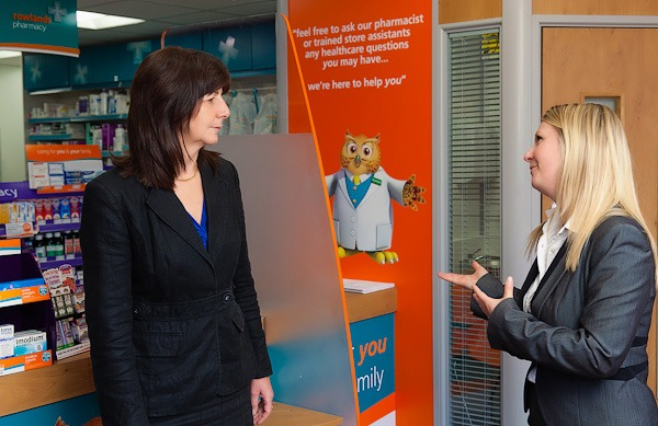 rowlands pharmacy area manager beth talking to lesley griffiths in rowlands wrexham