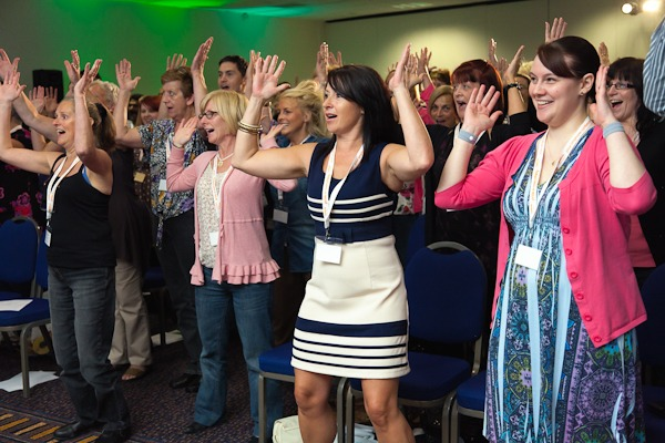 people in conference hall doing the HAKA at rowlands staff conference