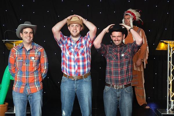 men in cowboy fancy dress on stage