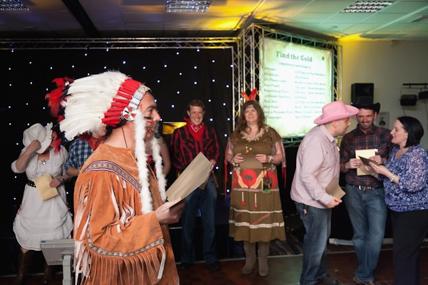 red indians and cowboys in fancy dress at conference