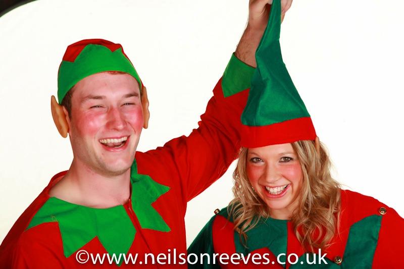 2 people dressed as elves fancy dress