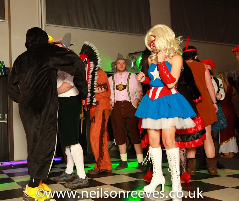 people dancing in fancy dress at the crown plazza manchester