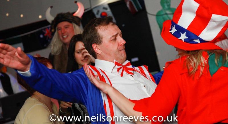 people dancing in fancy dress Rowlands Pharmacy