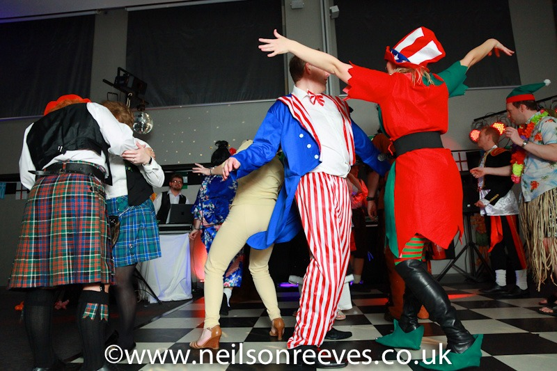 people dancing in fancy dress at crown plazza manchester