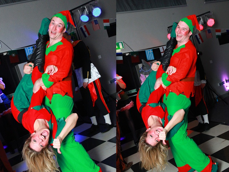 couple dancing dressed as elves at fancy dress party