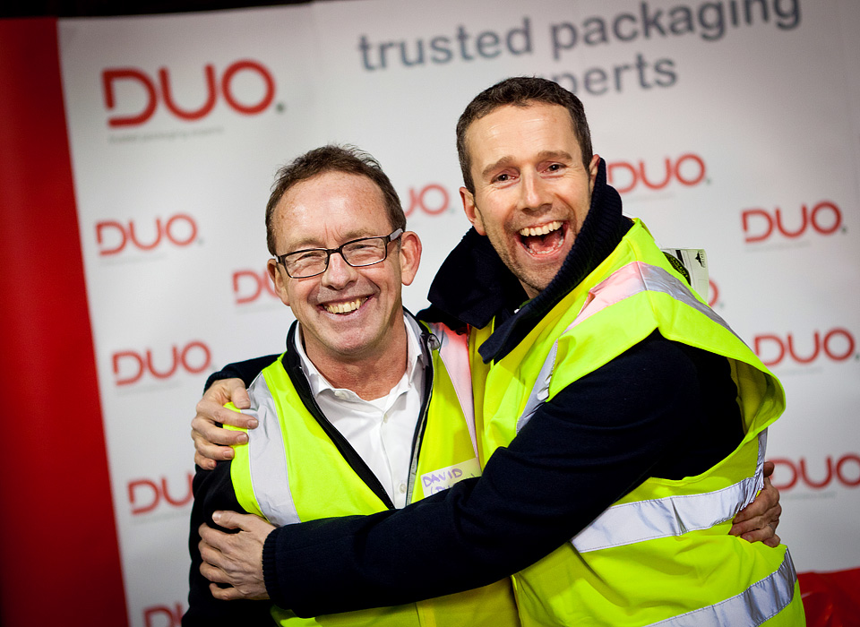 Max Rushden Soccer AM and Dave Billington Duo UK max bear hugging dave in front of duo branding