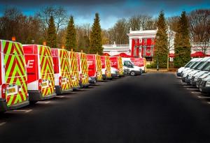 huge line of virgin media vans parked outside franky and benny's in the trafford centre car park