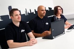 commercial photography brochure image 3 people sat at a desk watching a screen