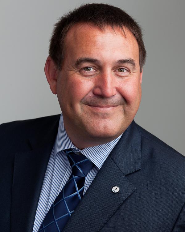 corporate headshot on grey background