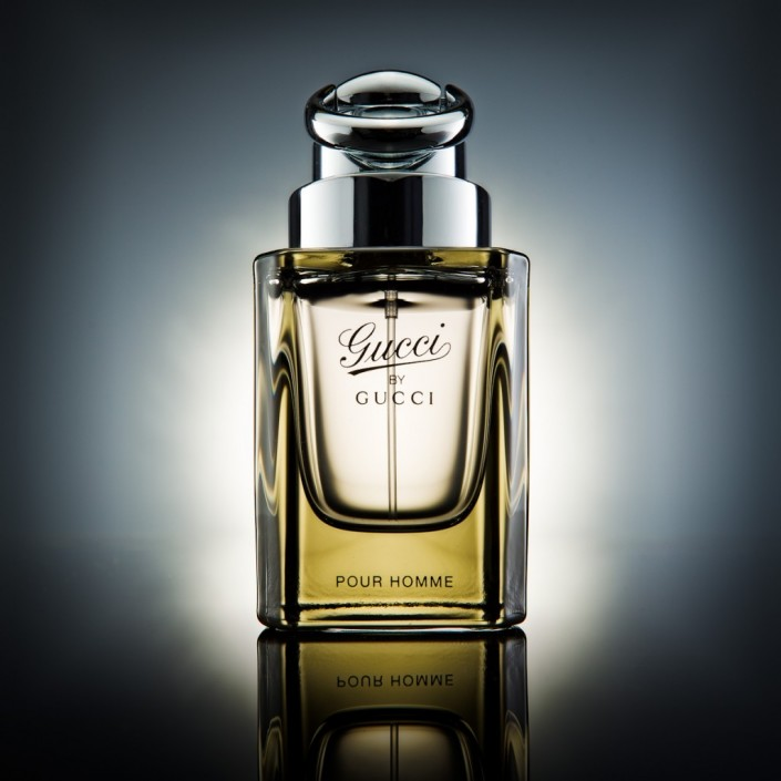 Product photography hero shot of gucci bottle