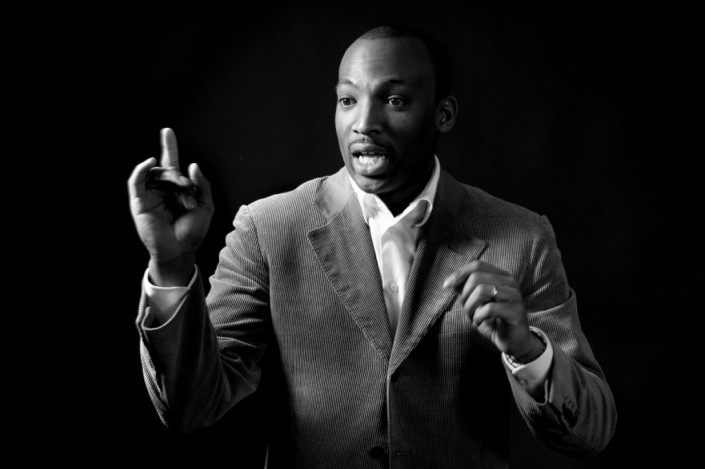 Black man public speaking in black and white