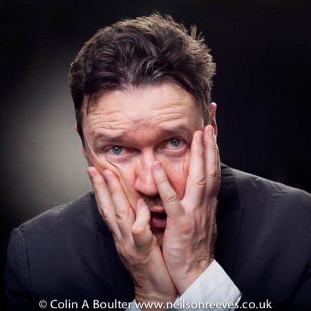 Portrait featuring Ian pulestion-davies with hands on face in a pained expression