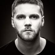 Black and white actor headshot sam woodall