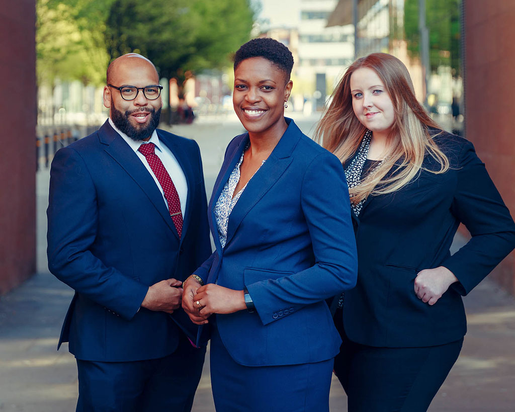 3 young business people photographed outside