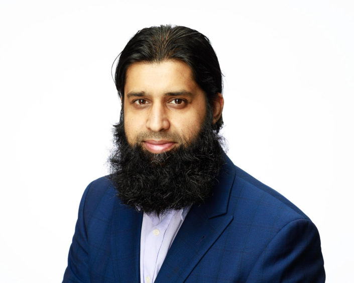 Asian business man. Muslim style beard wearing blue suit smiling on camera with pure white background