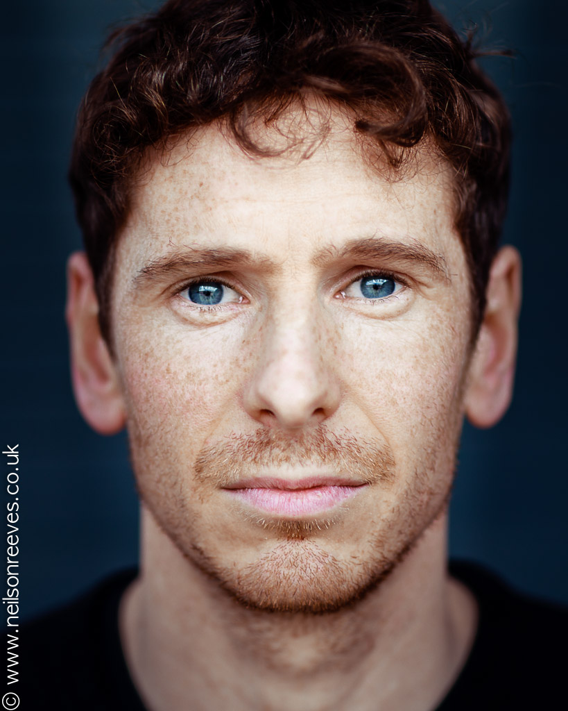 close crop actor headshot featuring actor Gerard kearns with freckles and stunning blue eyes