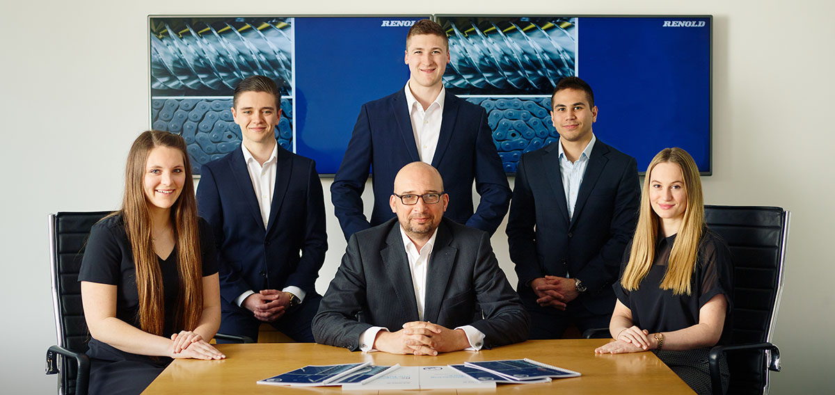 corporate group shot young graduates with middle aged businessman in the middle
