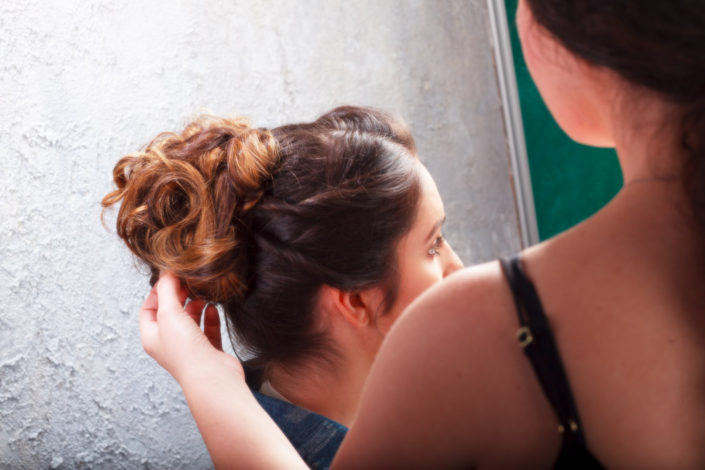 Behind the scenes showing beautiful messy bun created by professional MUA Rebecca Tupman