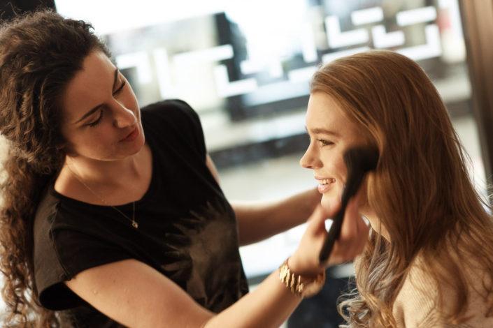 Rebecca Tupman applying makeup to actor Amy-James-Kelly