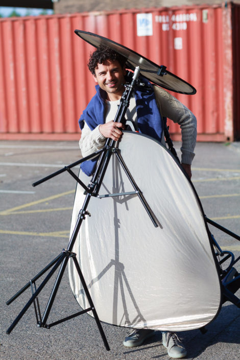 Actor Ryan Thomas overloaded with photography gear he is kindly carrying