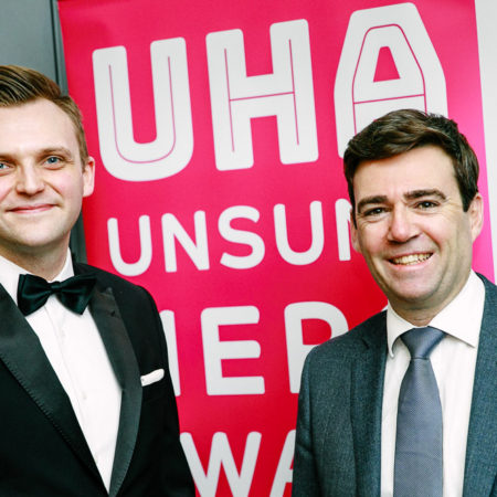 Andy Burnham and Mark Cherry UHA awards banner